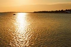 在日落的海运表面 库存照片