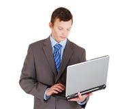 与膝上型计算机的新生意人 库存照片