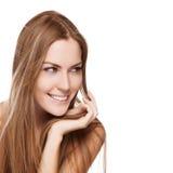 有平直的长的头发的新微笑的妇女 免版税库存图片