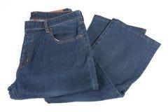 被折叠的蓝色牛仔裤 免版税库存照片