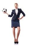 有橄榄球的女实业家 库存照片