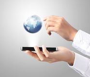 移动电话在手中 免版税库存图片