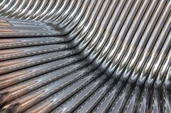 扭转的镀铬物管道 库存图片