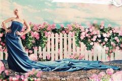 与美丽的妇女的艺术拼贴画在庭院里 库存照片