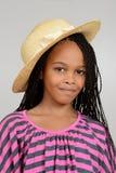 Молодая африканская девушка нося шлем сторновки Стоковые Изображения RF