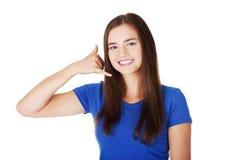 可爱妇女打手势 免版税库存图片