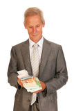 Старший человек с деньгами Стоковые Фотографии RF