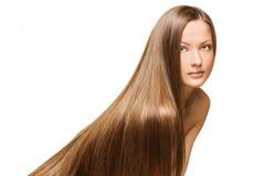 秀丽妇女。 长的头发 免版税库存图片