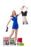 尝试新的衣物的可爱的妇女 免版税库存图片