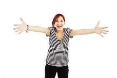 十几岁的女孩举武装的手在您 免版税库存照片