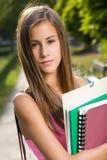 美丽的青少年的学员女孩。 免版税库存照片