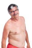 愉快的赤裸上身的老人 免版税库存照片