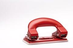 红色办公室纸张打孔器 免版税库存图片