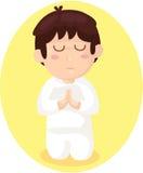 动画片男孩祈祷 免版税库存照片