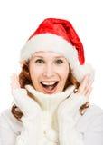 圣诞老人帽子的愉快的美丽的圣诞节妇女 免版税图库摄影