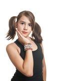 黑色顶层的青少年的女孩与猪尾微笑 免版税库存图片