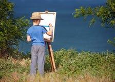 开始他的新艺术家工作,室外 图库摄影