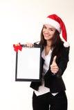 相当盖帽的圣诞老人的少妇 库存照片
