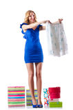 尝试新的衣物的可爱的妇女 免版税库存照片