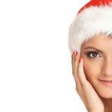 一个少妇的纵向圣诞节帽子的 免版税图库摄影