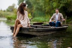 Пары в шлюпке Стоковое Изображение