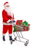 执行他的圣诞节购物的圣诞老人 库存图片
