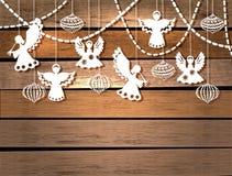 与天使和玩具的圣诞快乐看板卡 免版税库存照片