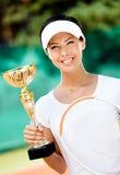 女性网球员赢取了竞争 免版税图库摄影