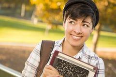 看混合的族种的女学生画象  免版税库存照片