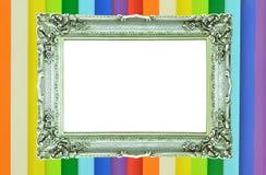 Εκλεκτής ποιότητας ασημένιο πλαίσιο εικόνων στο ζωηρόχρωμο τοίχο Στοκ Φωτογραφίες
