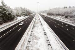 荷兰语高速公路在与雪的冬天 库存图片