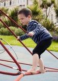 Ребенок на спортивной площадке Стоковые Изображения