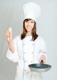 鸡蛋和厨师 免版税库存照片