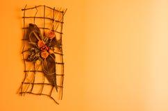 橙色墙壁装饰 库存图片