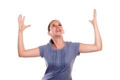 庆祝胜利的愉快的兴奋少妇 免版税库存照片