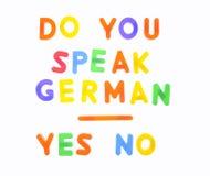 您讲德语。 库存图片