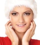 一名愉快的妇女的纵向毛皮圣诞节帽子的 库存图片