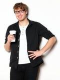 年轻人饮用的咖啡纵向 图库摄影