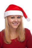 圣诞老人帽子的新白肤金发的妇女 图库摄影