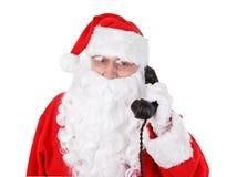 圣诞老人接受一个电话 免版税库存图片