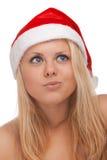 圣诞老人帽子的新白肤金发的妇女 免版税库存图片