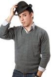 戴黑帽会议的英俊的人 免版税库存照片