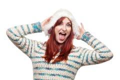 毛茸的冬天帽子的笑的妇女 免版税库存照片
