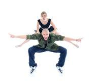 体操运动员跳过交谈者 免版税图库摄影