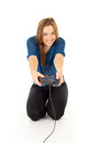 打电子游戏的愉快的女孩 免版税库存图片