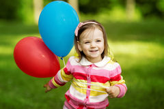 与气球的女孩作用 库存图片