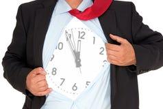 与时钟的生意人 库存照片