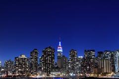 曼哈顿地平线在晚上,纽约 图库摄影