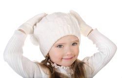 温暖的帽子的逗人喜爱的查出的小女孩和手套 免版税库存照片