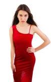 Προκλητική νέα γυναίκα στο κόκκινο φόρεμα Στοκ Φωτογραφίες